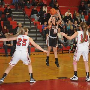 Cassidy Purgiel gets a shot up over Lexi Szymoniak and Elise Arkwood. (Photo by Angie Asam)