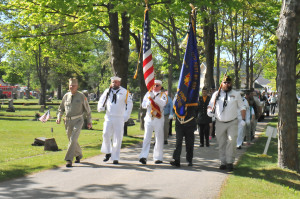 A color guard led the processional into Memorial Park Cemetery to honor the dead on Memorial Day. (Photo by Angie Asam)