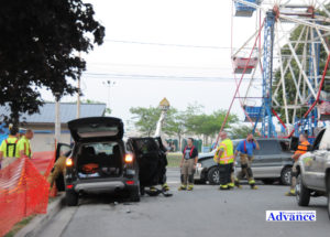 Emergency personnel work at the scene of a crash near the Ferris Wheel at the Nautical City Festival last month. The alleged driver vehicle at the center of the investigation the will be in court Monday as the case continues after some charges were dropped this week.