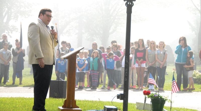 DEVIN POMMERENKE delivered a heart-felt Memorial Day speech on a foggy morning in Memorial Park Cemetery, Rogers City.
