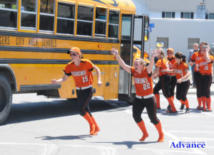 Seniors Hannah Dittmar and Mary Brege take a good luck run around the school bus that took them to the quarterfinal game Tuesday. (Photos by Richard Lamb)