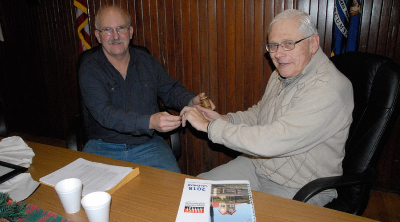 OUTGOING ONAWAY mayor Gary Wregglesworth passes along the gavel to his successor Chuck Abshagen, who will take over after the first of the year.									 (Photo by Peter Jakey)