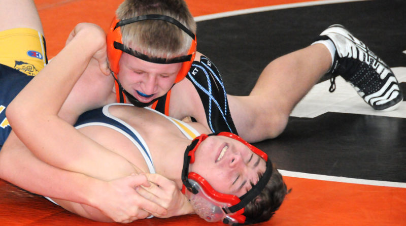 AUSTIN BIELAS (on top) did not let his opponent slither out of his control in last week's match. The Gaylord opponent was pinned by the Huron. (Photo by Richard Lamb)